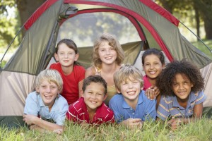 Group Of Children Having Fun In Tent In Countryside